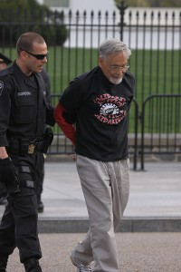 Jim being led away in handcuffs